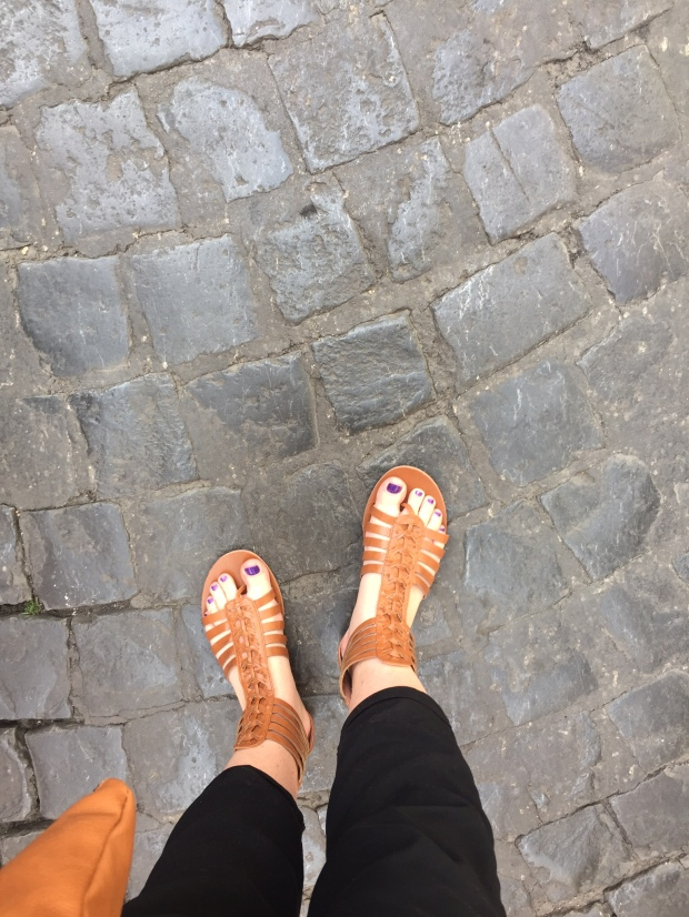 My one pair of two pair of shoes I brought on the trip. And those streets. So beautiful to think about the many people who have traveled on the streets of Rome.